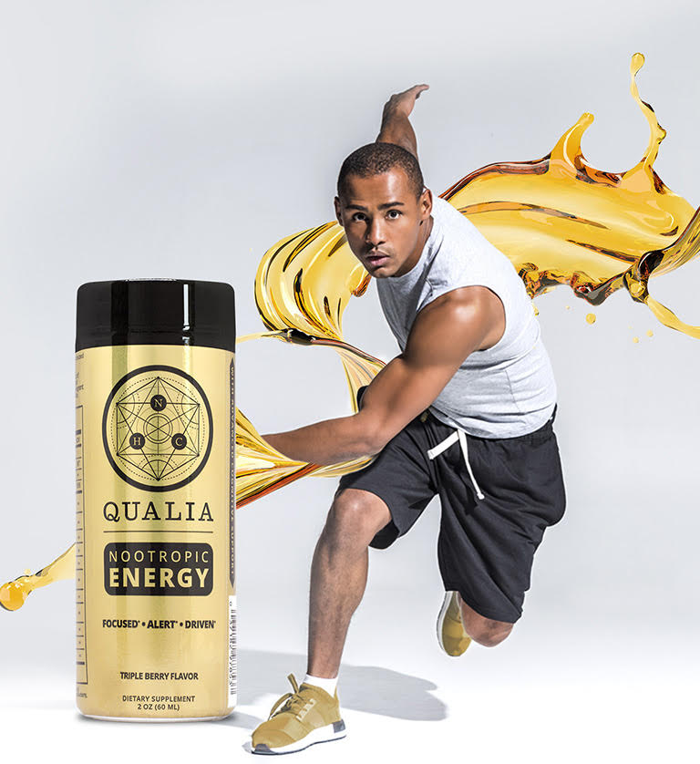 Qualia Energy Bottle, with man sprinting in the background.